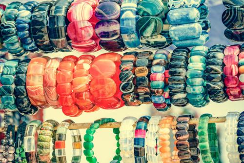 Obraz na plátně Colorful seed necklaces at craft fair