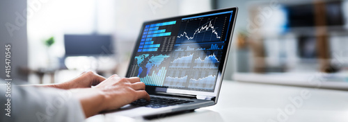 Businesswoman Analyzing Graph On Laptop