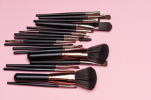 Make Up Brush Sets Arranged On Pink Background, Top View With Copy Space. Cosmetics Products.