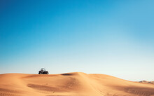 Minimalistic Desert View With Blue Sky, Sand Hill And One Buggy Quad Bike, Motor Sport Adventures, Driving Off-road