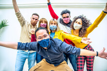 Multicultural People Covered By Protective Face Masks Smiling At Camera - New Normal Friendship Concept With Young Friends Having Fun Outdoor - Bright Filter