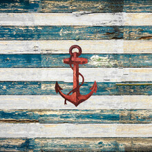 Rusty Red Anchor On Wooden Boards