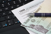 US IRS Internal Revenue Service Income Tax Filing Form 1040 With Pen On Keyboard.