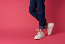 Female Feet White Sneakers Street Fashion Pink Background