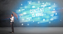 Handsome Businessman Defending With Umbrella From CONTENT IS KING Inscription, New Age Media Concept