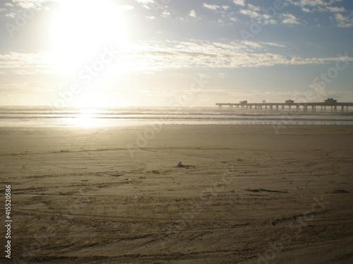sunset on the beach © Leandro
