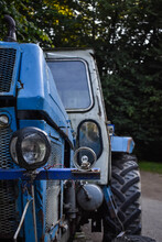 Vertical Shot Of An Old Blue Tractor