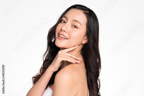 Beautiful young asian woman with clean fresh skin on white background, Face care Fotobehang