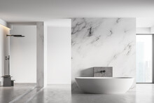 White Bathtub And Shower In Light Marble Bathroom With Window