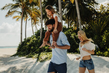 Family On Vacation At A Tropical Island
