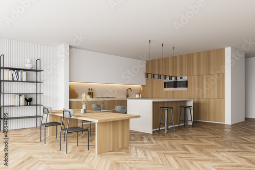 Fototapeta Wooden kitchen room with dining table and chairs, parquet floor obraz na płótnie