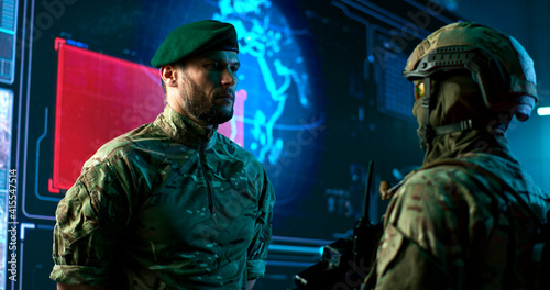 Male commander speaking with soldier in nuclear attack control center Fototapeta