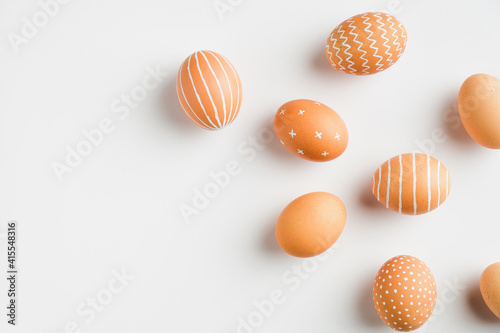 Obraz Happy Easter card. Simple painted Easter eggs isolated on white background. Flat lay, top view - fototapety do salonu
