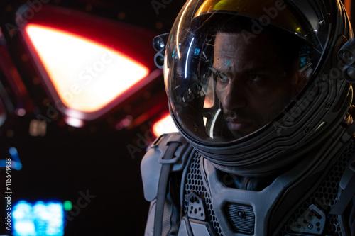 Obraz na plátně Portrait of African American Black male astronaut inside spaceship cockpit
