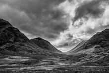 Majestic  Black And White Landscape Image View Down Glencoe Valley In Scottish Highlands With Mountain Ranges In Dramatic Winter Lighting
