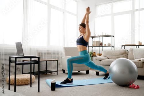 Fototapeta Woman doing exercise, online pilates training obraz