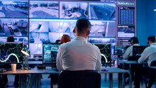 Male Spy Browsing Video And Map On Computers