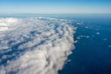 Cumulonimbus Clouds Over The Ocean