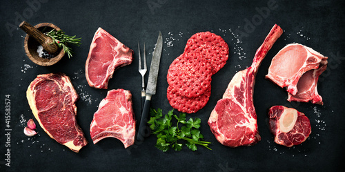 Fotografering Variety of raw cuts of meat, dry aged beef steaks and hamburger patties