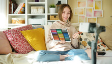 Beautiful Teenage Girl Recording Video Blog With Her Smartphone. Young Vlogger Shooting Vlog At Home. Teen Influencer Creating Content For Her Social Media Account.