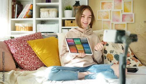 Fotografija Beautiful teenage girl recording video blog with her smartphone