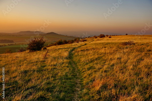 Grassy path on the top of Czech mountain Tabulová hora in Bavory, Pálava region in the beautiful sunny morning