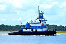Tugboat Cruising On The River At St. Augustine, Florida