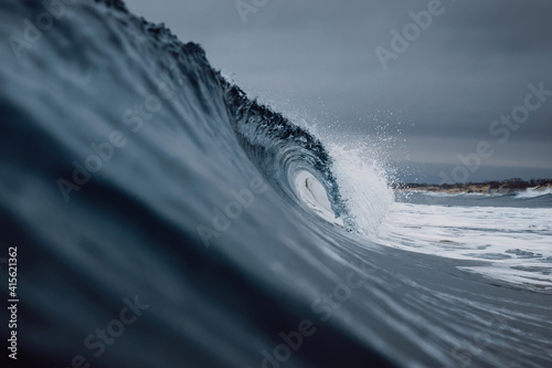 Obraz Perfect ocean waves with water cloudy dark sky. - fototapety do salonu