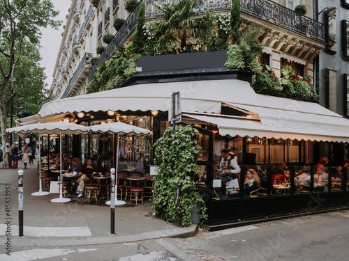 Fototapeta Boulevard San-German with tables of cafe in Paris, France