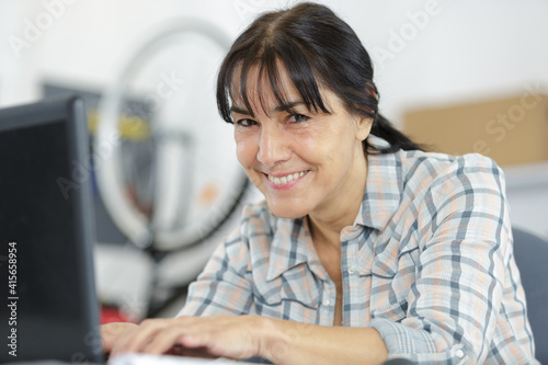 mature woman working in a bicycle repair shop