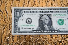 American Dollar Banknote And Bitcoin Coin Next To A Sheet And Pen On A Gold Background. Bank Image And Commercial Photo On Gold Background.