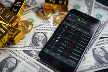 Smartphone Application. CoinGecko Logo On Phone Screen Close Up. On The Table In The Background American Money, Bitcoin And Shiny Gold Bars. Budapest, Hungary - February 10, 2021