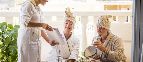 Fotografie, Obraz couple of two healthy and happy seniors taking and having fun using a massage an