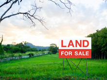 Land For Sale Sign On Empty Land.