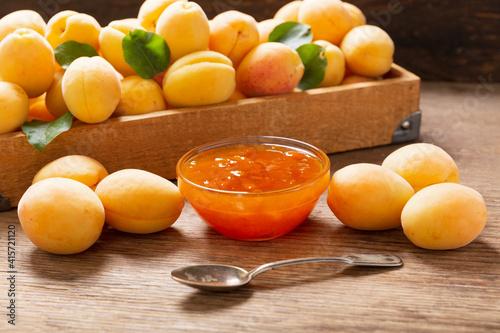 bowl of apricot jam with fresh fruits © Nitr