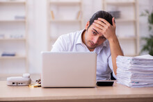 Young Businessman Employee Unhappy With Excessive Work In The Office
