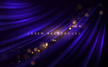 Abstract Blue Silk Background With Gold Glow Effect