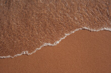 Ocean Wave Or Clear Sea On Clean Sandy Beach Summer Concept. Brown Color Filter.