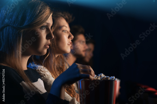 Friends at the cinema watching a movie Fototapet