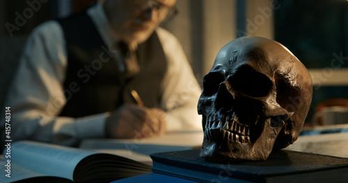 Fototapeta Academic professor studying a human skull obraz