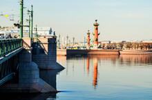 Saint Petersburg, Russia. The Neva River In Saint Petersburg Russia And Rostral Columns Of The Vasilievsky Island Spit