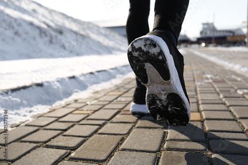 Fototapeta Man running outdoors on winter day, closeup. Sports exercises obraz