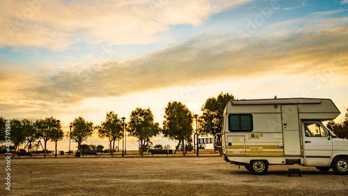 Camper car on beach at evening Fototapeta