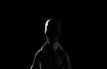 3d Illustration Of An Alien Grey In Darkness