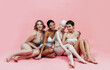 Leinwandbild Motiv Group of multiethnic women with different kind of skin posing together in studio. Concept about body positivity and self acceptance