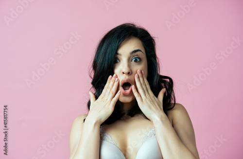 Fototapeta Image of a beautiful woman posing in lingerie on a pink colored background obraz