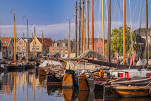 View Of The Harbor Of The Dutch Fishing Village Of Spakenburg In The Former Zuiderzee With Old Traditional Botter Fishing Boats.