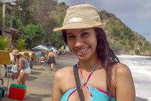 Caribbean Girl In A Village On The Edge Of The Mountain With Its Sea Of Strong Waves In Front In Chichiriviche De La Costa, Vargas Venezuela