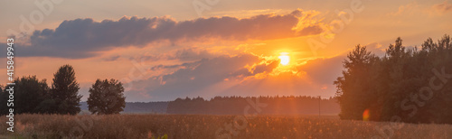 sunset over summer field - fototapety na wymiar