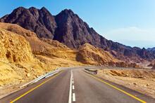 The Highway Runs Through The Mountains